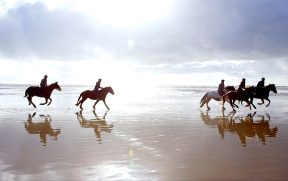 Filming horse riding on a beach in Carmarthenshire.
